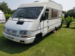 My old Campervan, a Hymer, sat in a field.