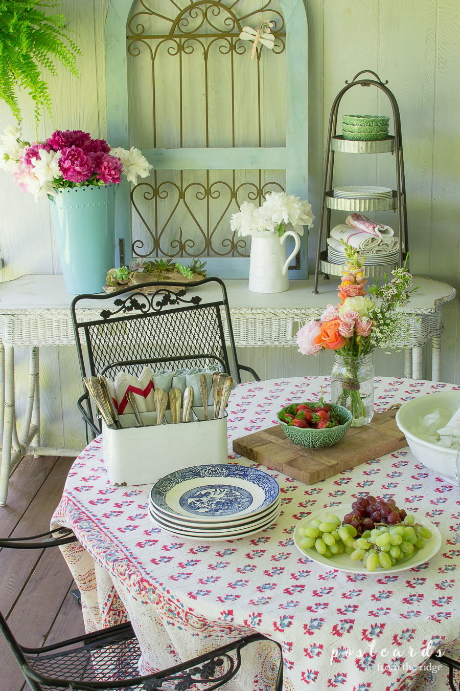 outdoor table with vintage items and flowers
