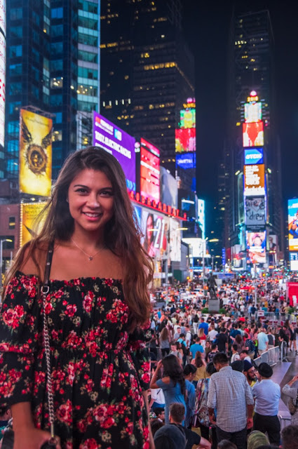New York Fashion and beauty writer Kelly Fountain wearing a floral red dress in Times Square