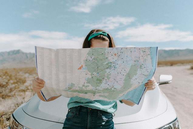 https://www.pexels.com/photo/woman-looking-at-the-map-3935702/