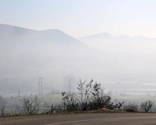 The narrow bridge in a hazy valley