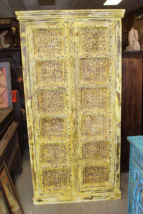 https://www.mogulinterior.com/reclaimed-antique-haveli-doors-yellow-storage-cabinet.html
