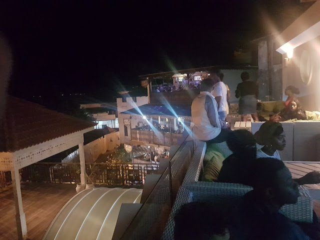 The view from 6 Degree's rooftop club with revellers in the foreground. Across are the three floors of Tatu, Stone Town's other happening place