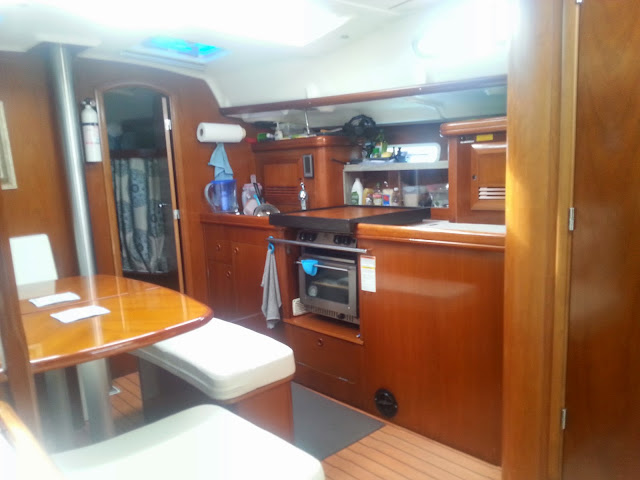interior of boat with new cushions and galley