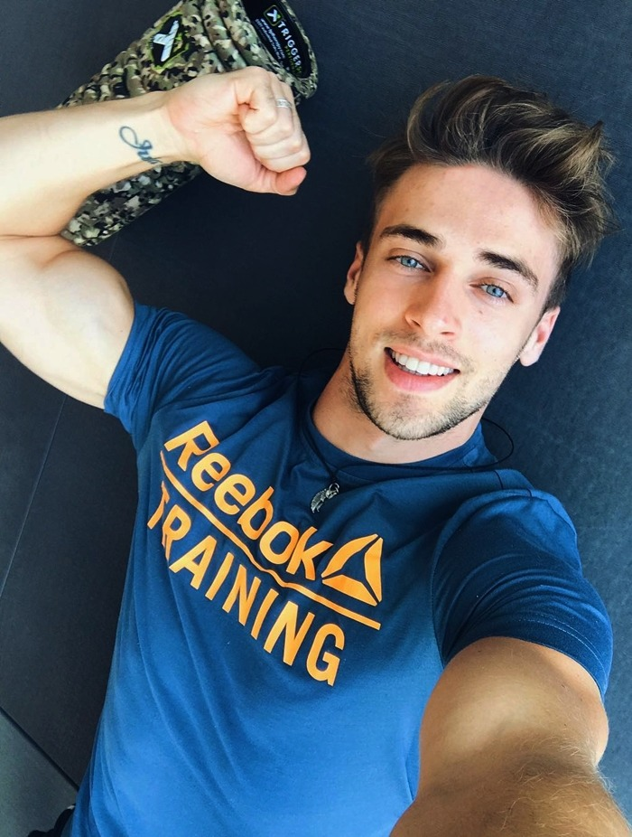 cute-blue-eyes-male-model-reebok-shirt-biceps-smiling