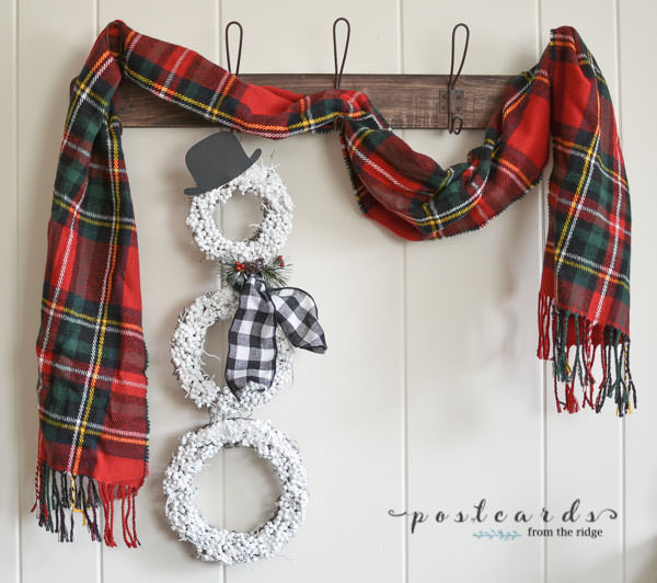 diy snowman wreath on wood wall rack with red plaid scarf