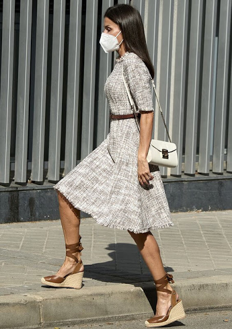 Queen Letizia wore a multicolor tweed dress from Adolfo Dominguez, and she wore tied leather wedges from Uterque