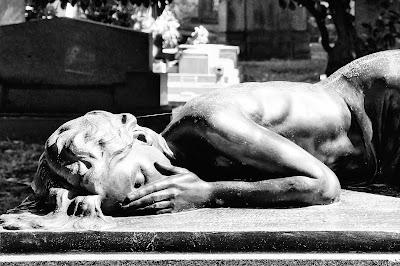 Grieving woman sculpture. Free image via Pixabay.