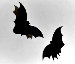 picture hanging solutions - bats cut out of black card