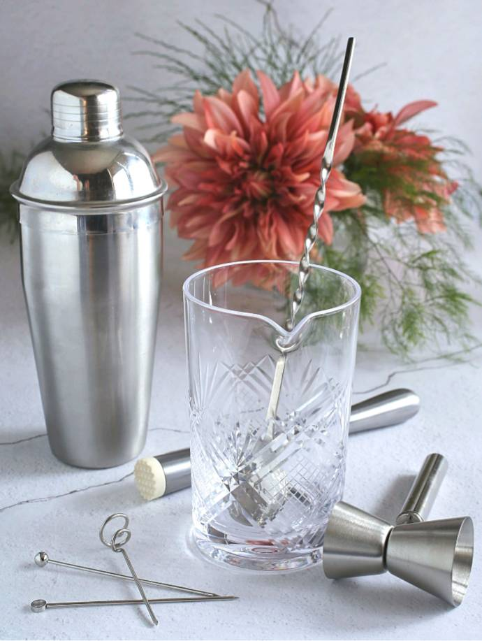 Easy guide for putting together a home bar including spirits, mixers, glassware and tools.