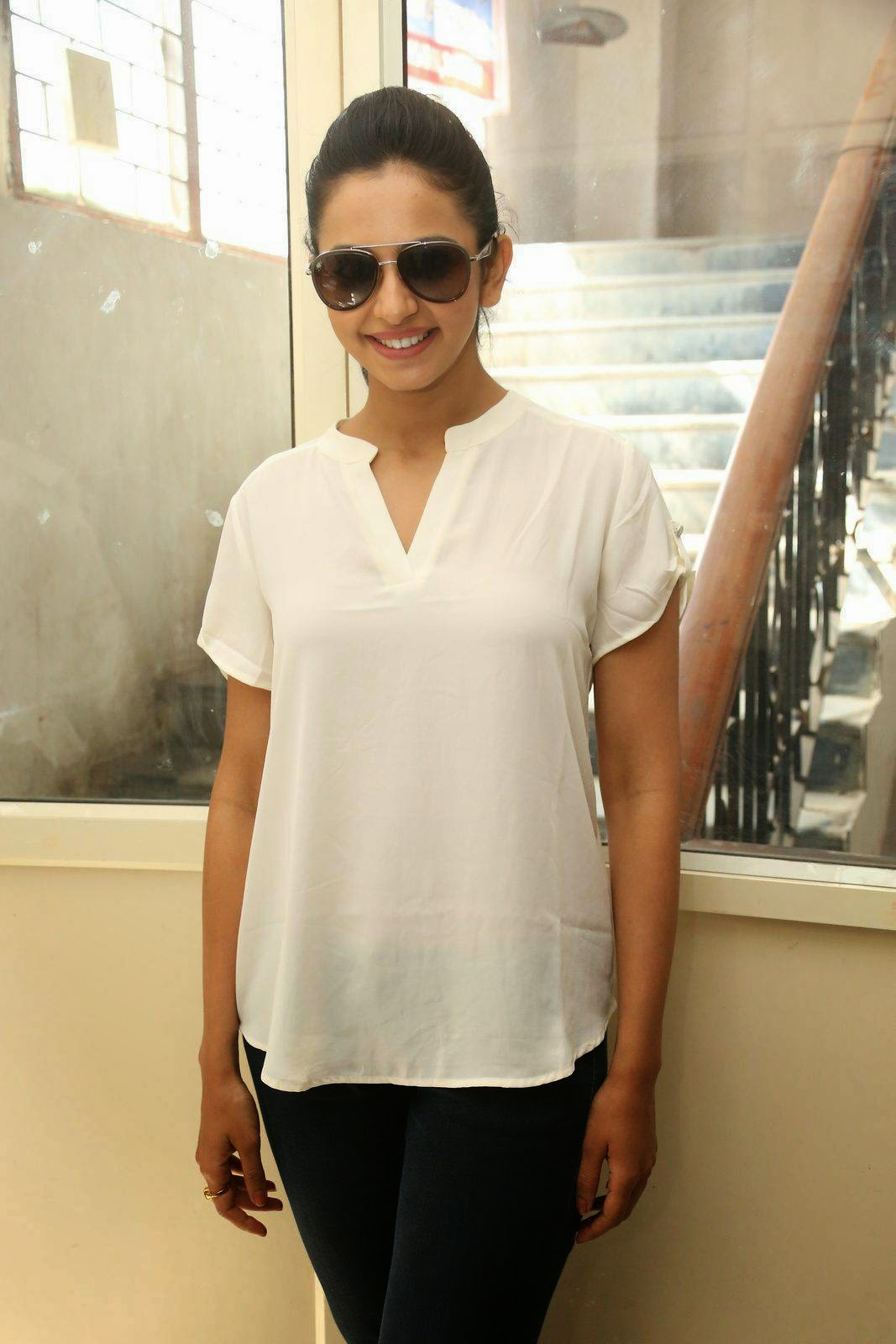 Rakul Preet Singh Stills In White Shirt  At Movie Theater Coverage