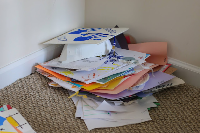A pile of kid's artwork at the end of the school year