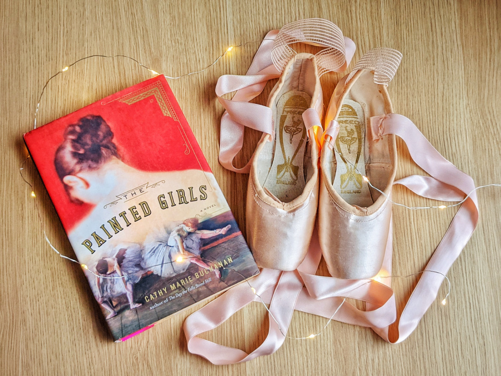 Novel The Painted Girls by Cathy Marie Buchanan, fairy lights, and pointe shoes.