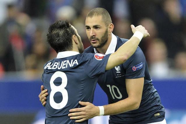 Karim Benzema hugs Valbuena during a France match