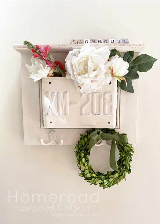 license plate shelf with wreath and flowers