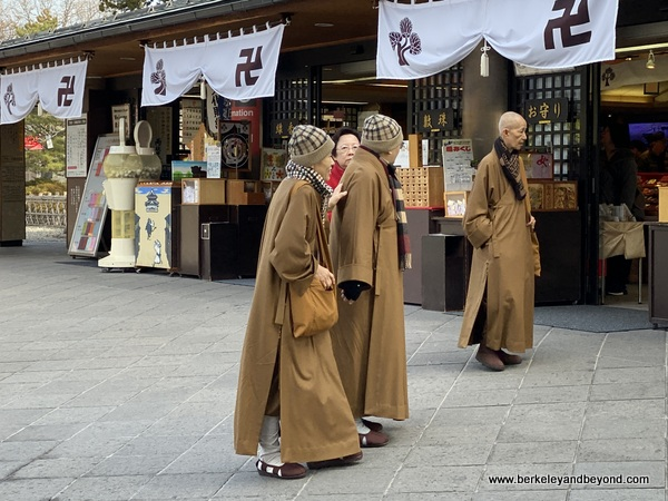 monks shopping outside Niomon Gate at Zenkoji Temple in Nagano City, Japan