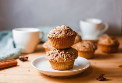 pumpkin muffins with cups of coffee ready to eat