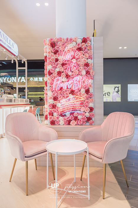 Central i city vanilla mille crepe kiosk highlighted area with floral, led neon signage and pastel pink color armchair