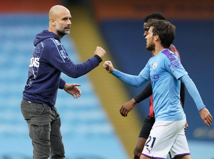 Man City's coach and captain Pep Guardiola and David Silva