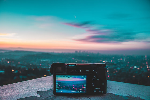 Camera cityscape at sunset - keeping valuables safe when travelling
