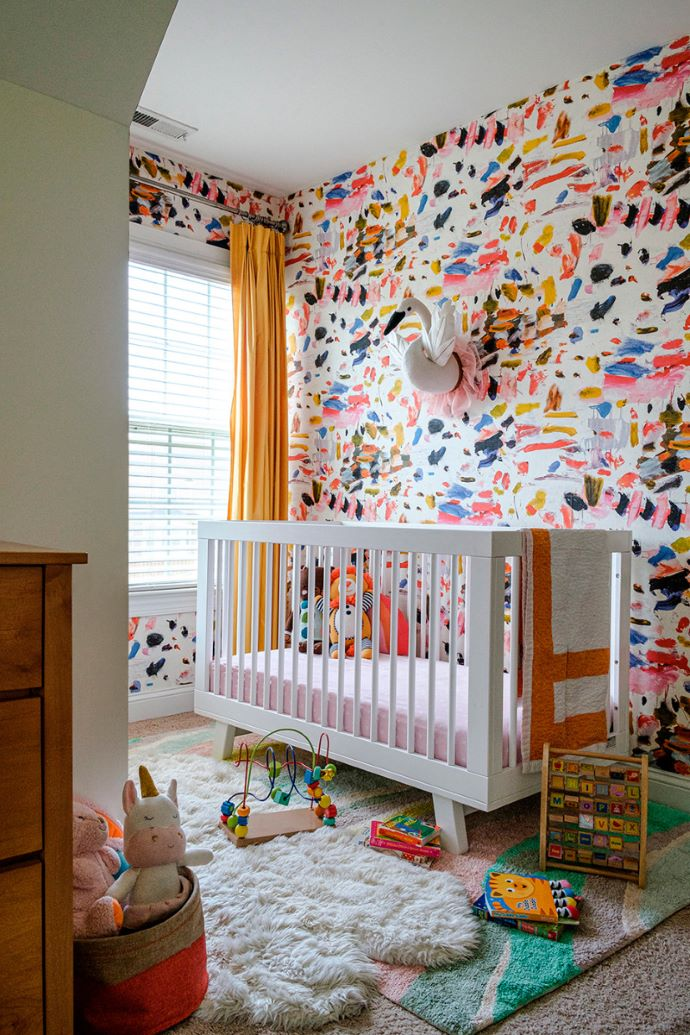 Beautiful nursery with fun wallpaper