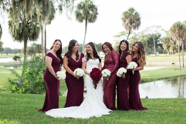 bride with bridesmaids in dark red burgundy color