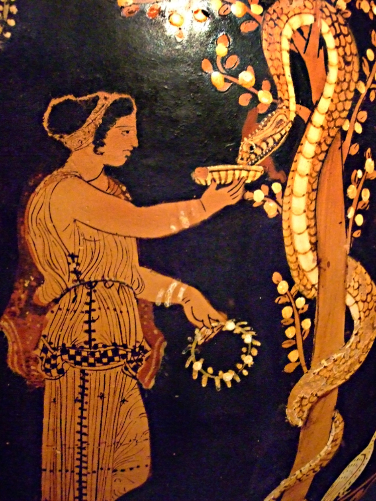 562b2debd9 Greek lekythos (oil jar) detail of a woman in the Garden of Hesperides,  feeding one of the sacred snakes who guard the golden apple trees there.