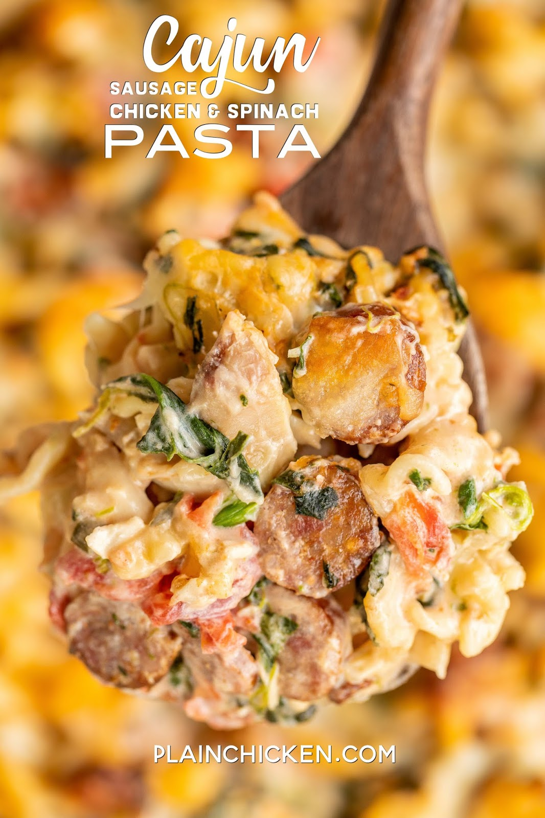 Cajun Sausage Chicken and Spinach Pasta - seriously delicious!! Pasta, andouille sausage, chicken, diced tomatoes, chive and onion cream cheese, heavy cream, mozzarella cheese, parmesan cheese and cajun seasoning. Makes a ton! Can divide into two pans and freeze one for later. Great for potlucks and dinner parties. Everyone LOVES this casserole! #cajun #mardigras #freezermeal #pasta #casserole