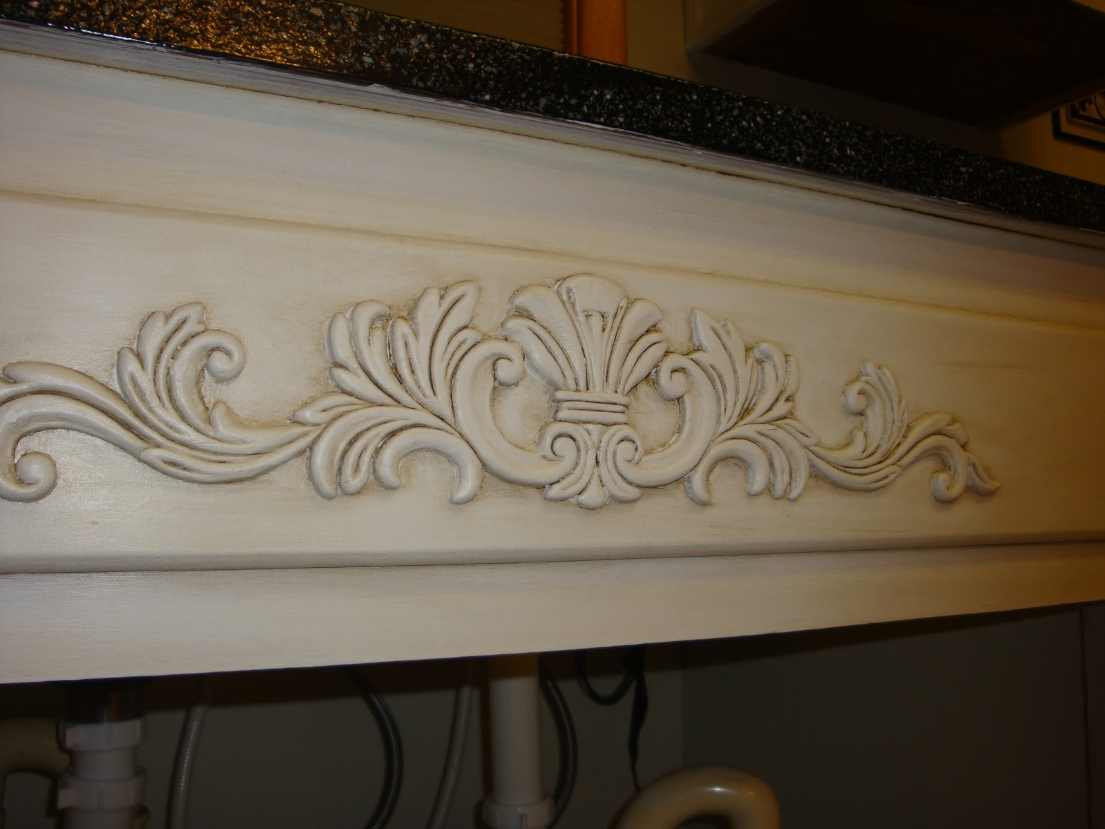 also added moulding around the end cupboards and an embellishment