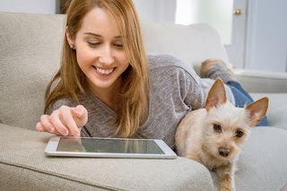 woman with tablet computer and dog