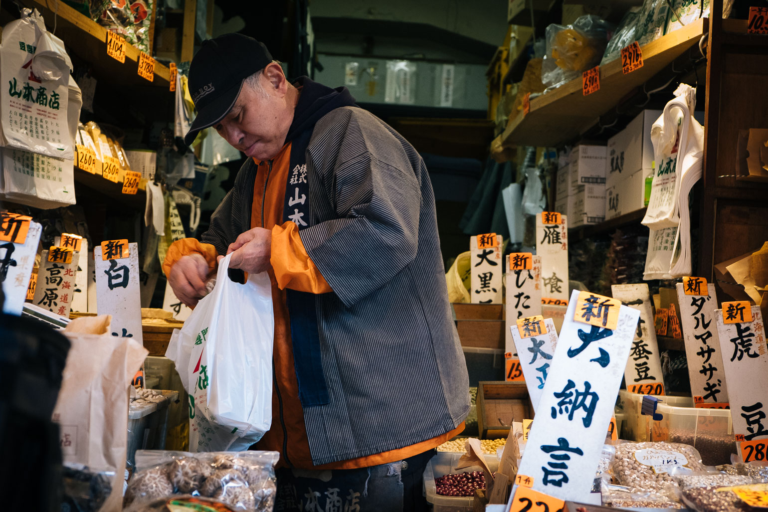 Shop keeper bags produce up at Tsukiji Fish Market