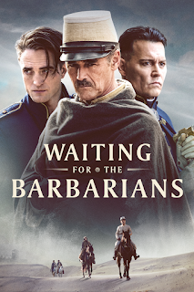 Poster featuring Johnny Depp, Robert Pattinson and Mark Rylance as soldiers superimposed above a desert horseback riding scene
