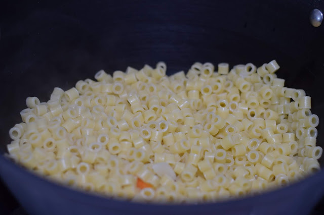 The cooked and drained pasta in the pot.