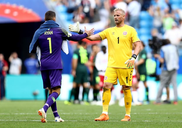 two keepers Mathew Ryan and Kasper Schmeichel shake hands after their 1-1 draw