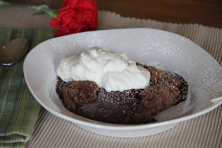 chocolate cake in a white bowl with whipped cream