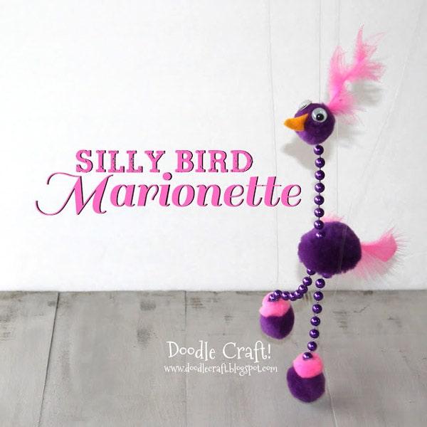Pom pom Marionette bird made with mardis gras beads, pom poms and feathers.