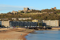 Autumn (Fall) panorama of Norman Keep and Dover Castle on the Eastern Heights above River Dour valley and Dover Harbour. Houses of Victoria Park above Gateway Flats apartments. Marine Parade Gardens and promenade. History, Travel, and Tourism.
