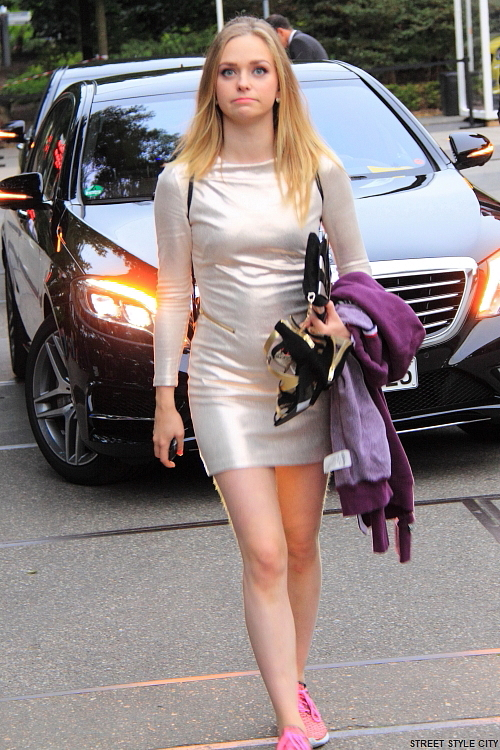 Woman wearing silver summer dress in the street. Street style fashion look.