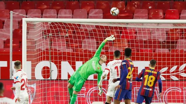 Barcelona keeper Ter Stegen in full flight against Sevilla in the Copa Del Rey