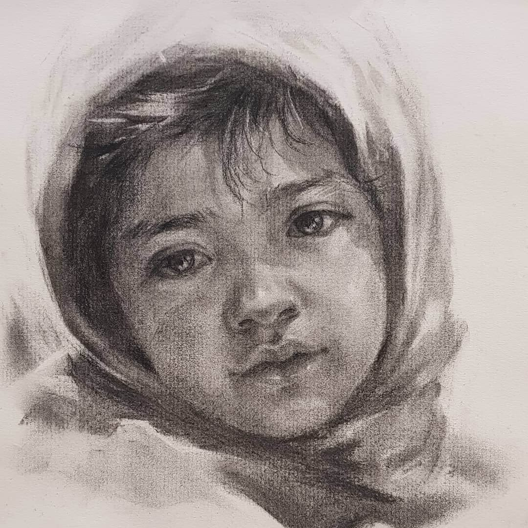 12-Jori-Charcoal-Portraits-of-Young-and-Old-plus-a-Clown-www-designstack-co