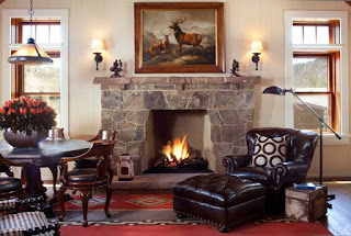 Stunning Stones as Rustic Fireplace Mantels in Sitting Space with Dark Lounge Chair and Wooden Breakfast Space