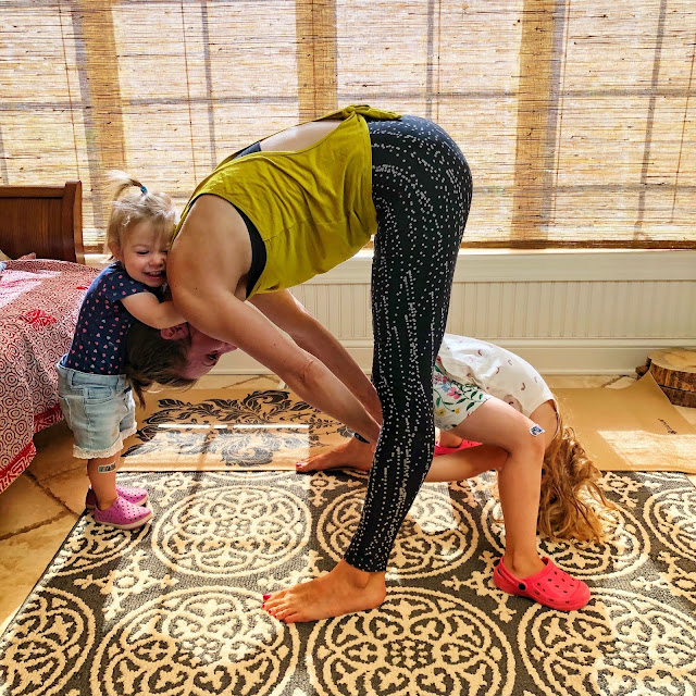 Laura Kowalski and her children practice family yoga.