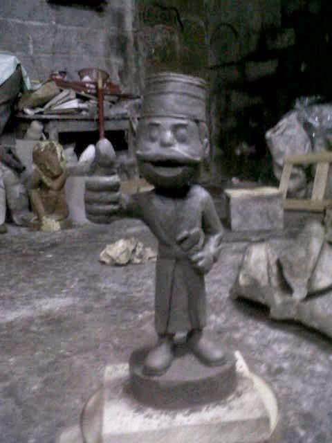 model patung kartun maskot