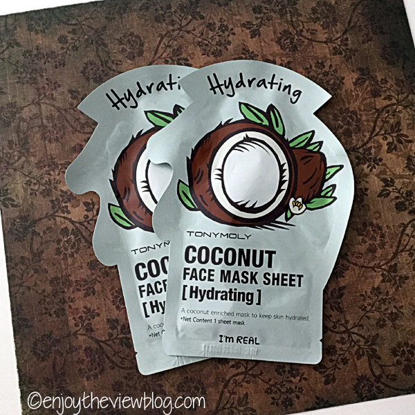 two Tony Moly I'm Real Coconut Face Mask Sheet packages lying on a brown floral surface