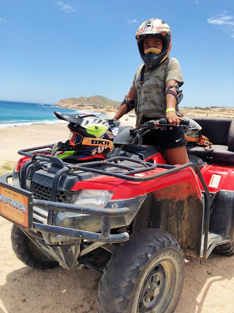 Miss Lauren Alston riding an ATV