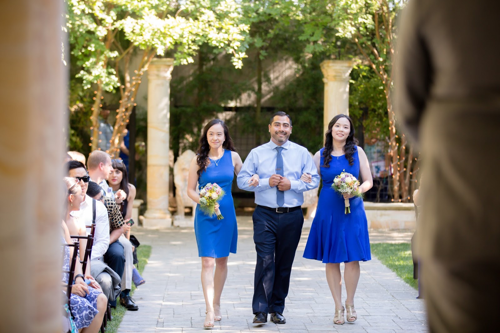 groomsman and bridesmaids walking down isle