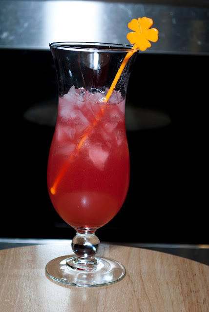 Hawaiian Punch cocktail, peach schnapps, amaretto, grenadine, pineapple juice, cranberry juice