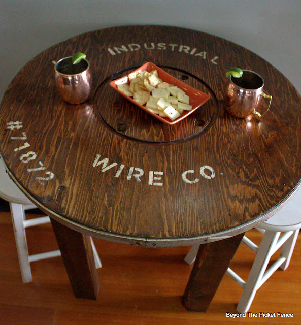 stencil a wire spool to make a cute rustic table