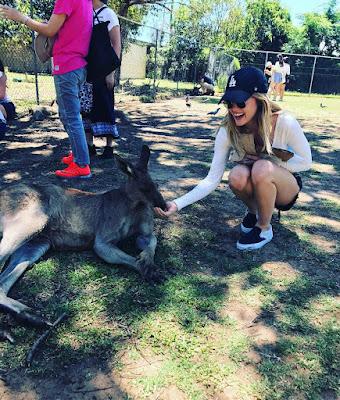Lucy Hale with kangaroo in Australia