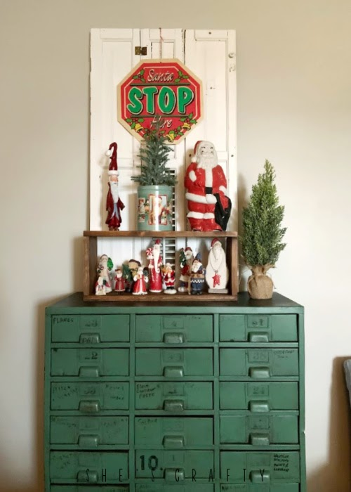 Vintage Christmas Decor Vignettes  |  see various ways to use vintage Christmas pieces in your home decor   |  living room, santa collection, industrial metal cabinet